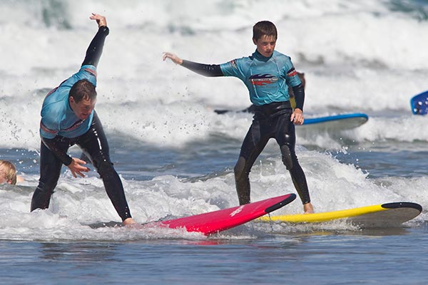 picture of a father and son surfing