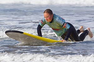 picture of a beginner surfer